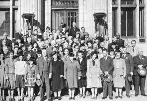 """In this photo, OKFB members pose for a photo in Salt Lake City during a trip back from the 1946 American Farm Bureau Federation Convention held in San Francisco, California. With more than 200 members attending, OKFB offered an all-expense-paid trip on a special Oklahoma-based, air conditioned train with comfort """"deluxe,"""" including side trips to the Grand Canyon, Yosemite National Park, and this return trip through Salt Lake City."""