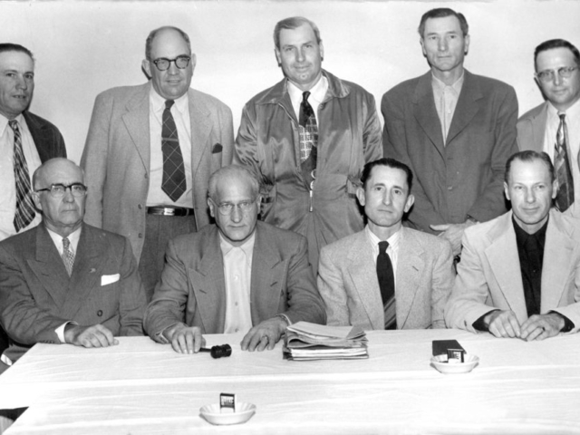 At the 1952 Oklahoma Farm Bureau Convention, two new Farm Bureau districts were created to increase membership, size and potential, bringing the total number of districts to nine. Pictured above is the first nine-member OKFB Board during their January meeting. Seated are (left to right) J.Y. Victor, Secretary; John I. Taylor, President; Lewis H. Munn, Vice President; and Darrell McNutt, Treasurer. Standing are (left to right) Mart Fowler, Harold Davis, F.W. Kannady, C.E. Weller and Glen Johnson.