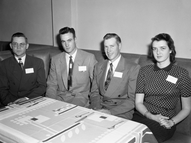 During the Cleveland County Junior Farm Bureau organizational banquet in Norman in 1953, more than 50 members selected officers to lead their newly formed group. The officers elected were (left to right) Joe Merkle and Bob Bates, Vice Presidents; J.C. Shroyer, President; and Patsy Steele, Secretary.