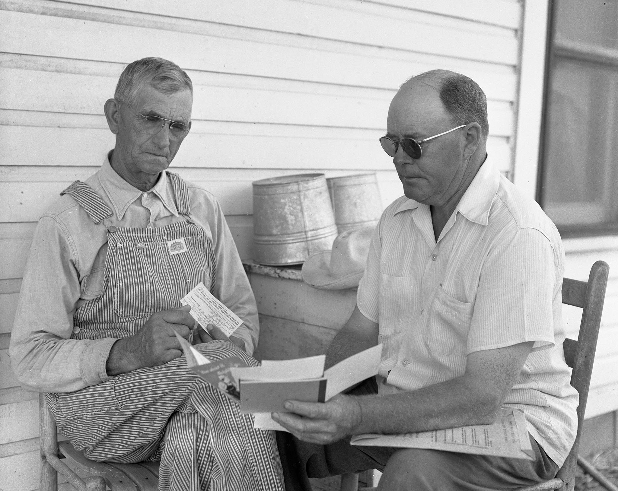 W.A. Cassell of Elmore City (left) signs up for his Garvin County Farm Bureau membership with A.J. Chapman, Membership Committee Co-chairman. Cassell was the first new member to be added in the county during in the organization's 1953 campaign.