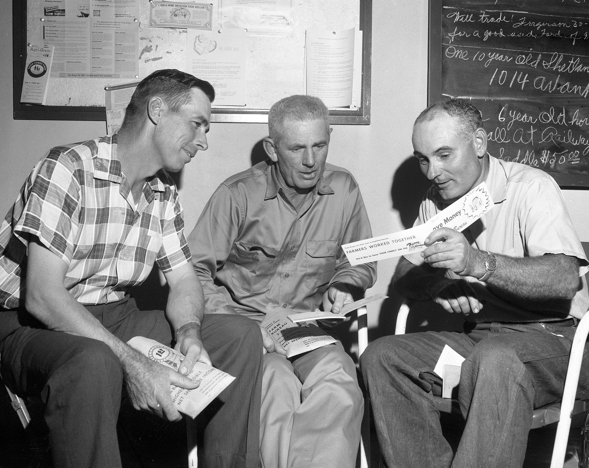 This photo was taken at a Custer County Farm Bureau membership kickoff held at the county office on October 7, 1958. Pictured are (left to right) Roy Driscoll, Custer County Farm Bureau Board member from Clinton; Wayne Foster, county board member from Weatherford; and Con Burgtorf, Membership Chairman from Custer City.