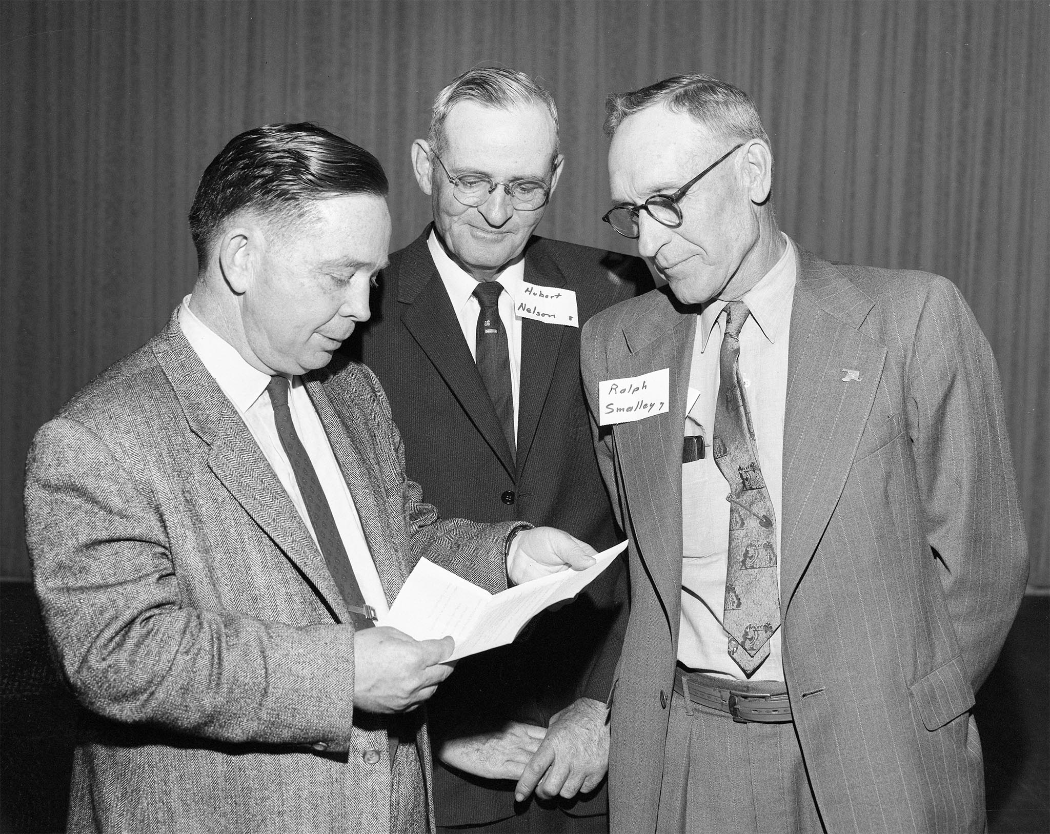 Congressman Carl Albert (left) met with representatives of county Farm Bureaus in his district at a Farm-Bureau-sponsored get-together in McAlester in 1959. Albert is shown here with McCurtain County's Hubert Nelson (center) and Pittsburg County's Ralph Smalley.