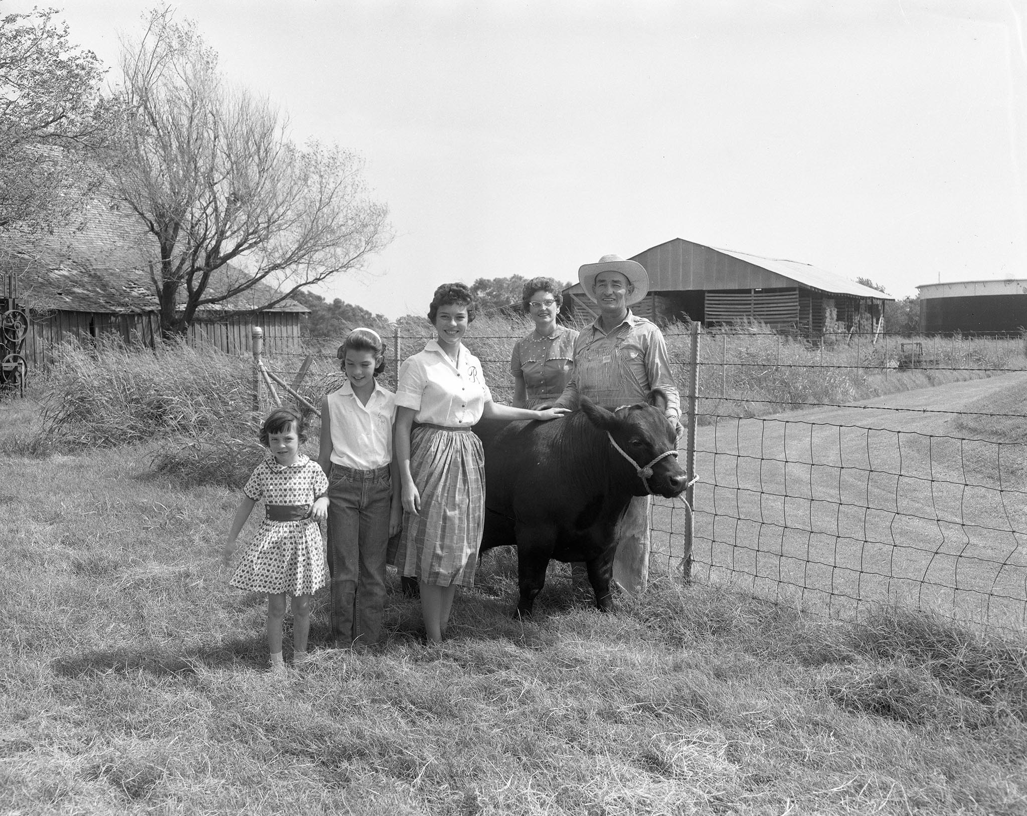 The 1960 Farm Family of the Year contest was limited to families who had lived on an Oklahoma farm for at least the last five years with at least 60 percent of their income coming directly from farming or ranching. The 1960 award was presented to the Darold Butler family of Pauls Valley. The Butlers and their five daughters lived on a highly diversified farm in Garvin County, where they raised black and red Angus cattle, alfalfa, corn, cotton, broomcorn, maize, soybeans, wheat, oats, vetch and barley.