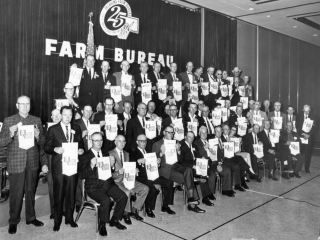 "County Farm Bureaus were competitive in meeting their membership goals. Each county was encouraged to meet their county quota by renewing at least as many memberships as the previous year, plus one. Successful counties received an award at the annual Oklahoma Farm Bureau Convention. Pictured here are the 1967 ""Quota Busters,"" comprised of representatives from counties that made their membership quotas. A total of 70 counties reached quota in 1967, setting a new all-time high for state membership by adding 6,000 more members than the previous year."