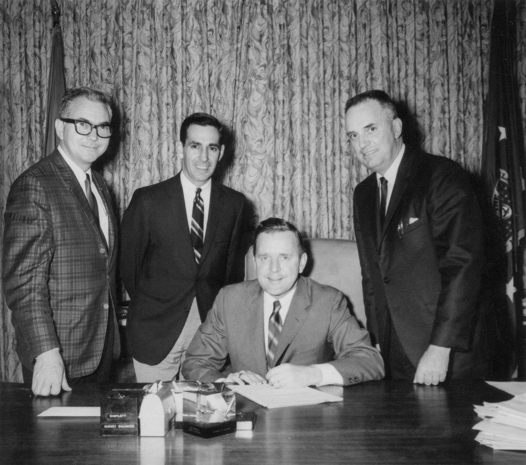 In 1968, Oklahoma Farm Bureau drafted a bill referred to as the Right-to-Market bill, which increased penalties and specifically prohibited interference by force, coercion or intimidation of persons seeking to market farm products. The bill was aimed at giving additional protection against violence, such as that which occurred in the Midwest in prior years during withholding actions of the National Farmers Organization. This photo was taken as Gov. Dewey Bartlett signed the Farm-Bureau-sponsored bill into law as OKFB Executive Secretary Kenneth McFall, Sen. Anthony Massad of Frederick and Rep. Harold Hunter of Waukomis looked on. Massad was the Senate author for the bill, and Hunter was one of the chief supporters of the bill in the House.