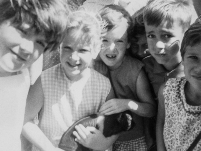 As part of a public relations program of Oklahoma County Farm Bureau, OKFB member Roger Murphy invited groups of children from Midwest City to visit his farm west of Edmond in 1969. Most of the children who came had never been close to a pig before.