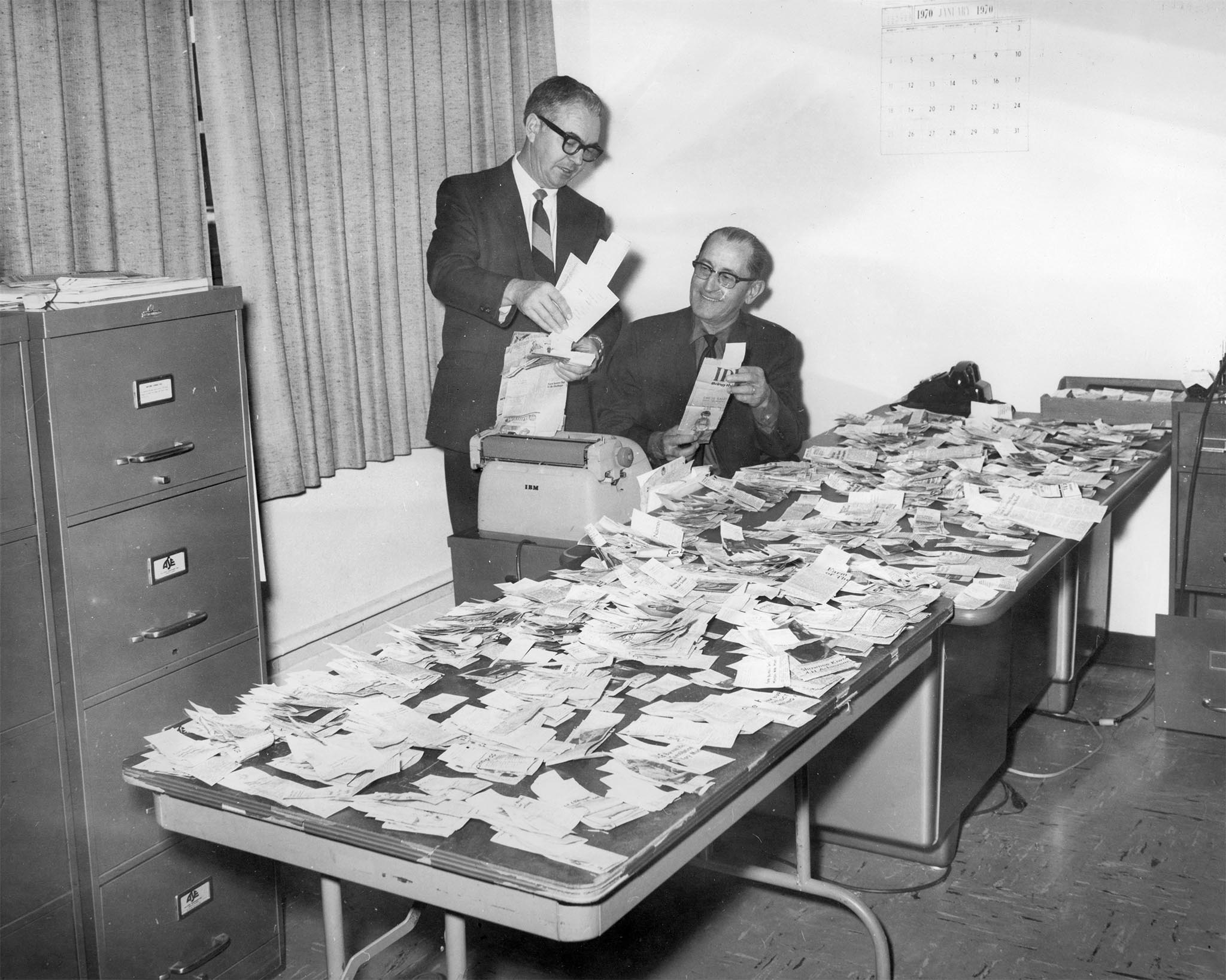Keeping up with the latest legislative and county news is an important part of Oklahoma Farm Bureau. This 1970 photo features Lewis H. Munn, OKFB President (right), reviewing newspaper clippings about the organization's activities with Kenneth McFall, Executive Secretary. The stories, gathered by a press clipping service, represent news coverage from nearly every newspaper in Oklahoma on topics ranging from county board meetings to farm news on the state level. Clippings were grouped and returned to appropriate county Farm Bureaus featured in the stories.