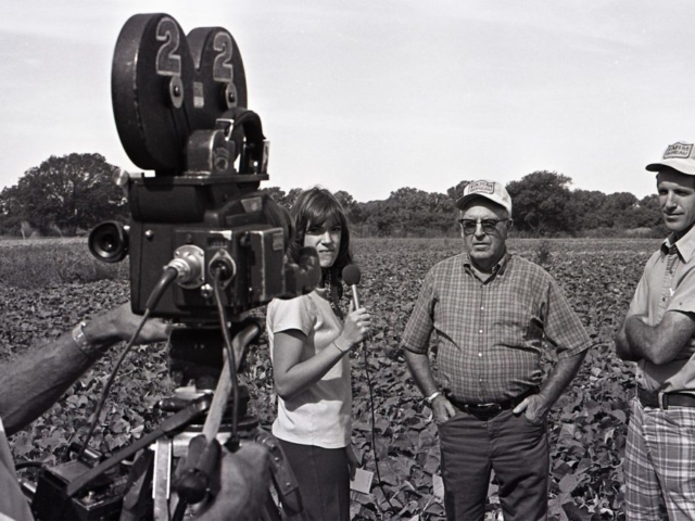 In this photo from 1975, OKFB member Eugene Conrad and his father, Chester, both of Bixby, spoke to a reporter from Tulsa's KTEW-TV about the advantageous uses of agriculture pesticides and herbicides in food production.