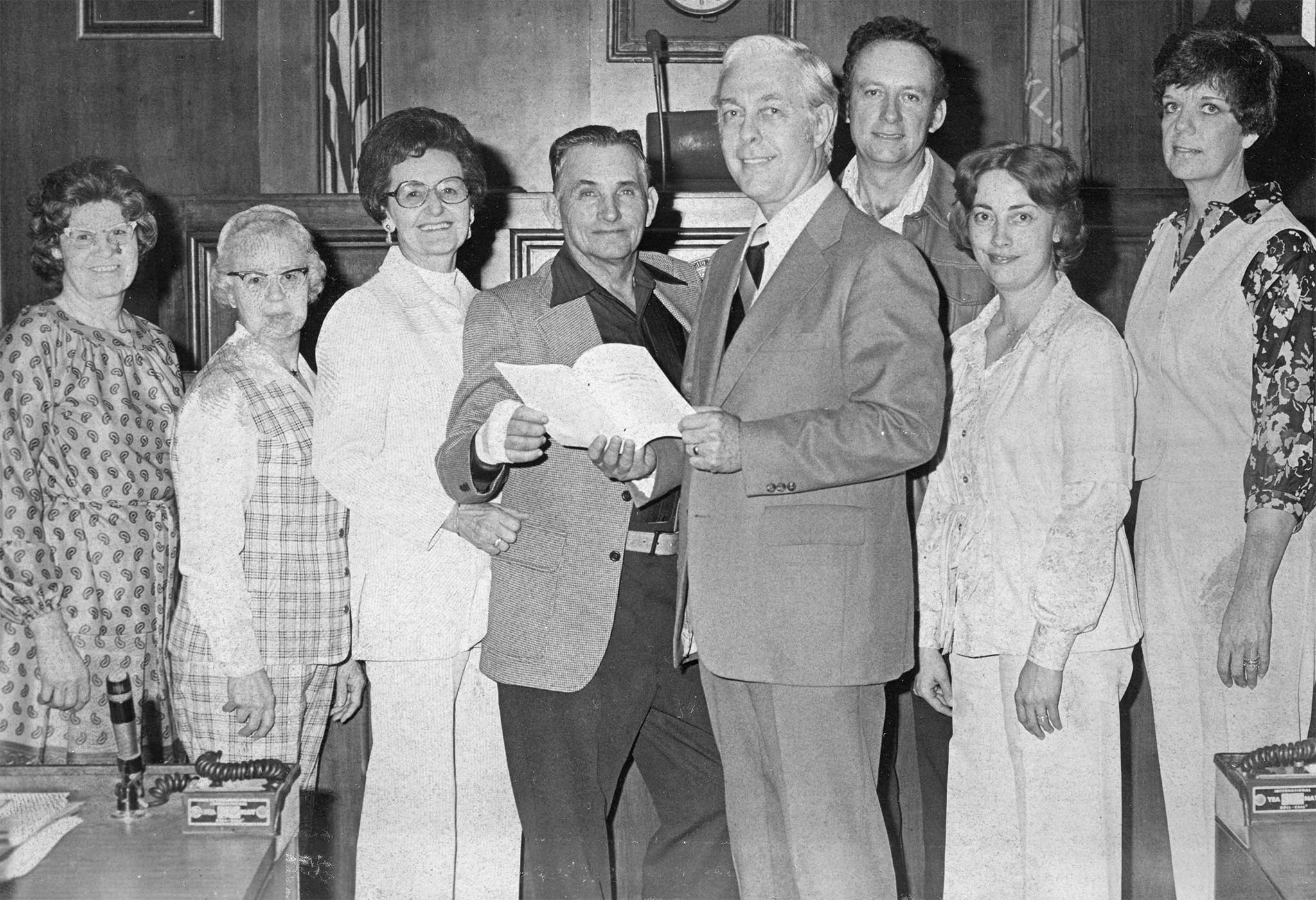 Here, representatives of the Muskogee County Farm Bureau met with State Sen. John Luton, Senate Majority Leader Whip, to discuss agricultural matters in 1979. With Sen. Luton are (left to right) Mrs. Bob Murr of Oktah, Mrs. Dick Helmer of Route Three, Mr. and Mrs. Jim Leeds of Fort Gibson, Sen. Luton, Mr. and Mrs. Robert Plunkett of Route Two and Mrs. Arlie Perry of Fort Gibson.