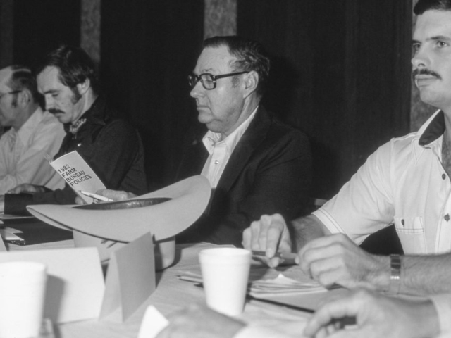 Here, delegates to the 1982 State Resolutions Committee meeting in Oklahoma City focus much of their attention on proposals regarding county government finances and funding for county roads and bridges. Delegates approved a resolution calling for a 2-cent-per-gallon tax on gasoline to be used to repair county roads and bridges.