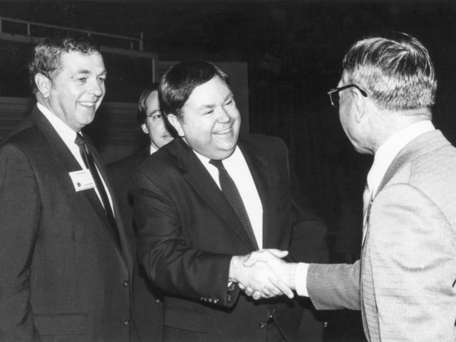 This photo, taken at the 1983 American Farm Bureau Federation annual meeting in Dallas, shows U. S. Sen. David Boren (middle) shaking hands with fellow Oklahoman Emanuel Fuchs of Kiowa County (right), while AFBF President Robert Delano stands by. Boren, an Oklahoma democrat from Seminole, was one of the featured speakers at the conference. About 200 Farm Bureau leaders from Roger Mills, Custer, Washita, Beckham, Kiowa, Greer, Harmon, Jackson and Tillman counties attended the 1982 national meeting.
