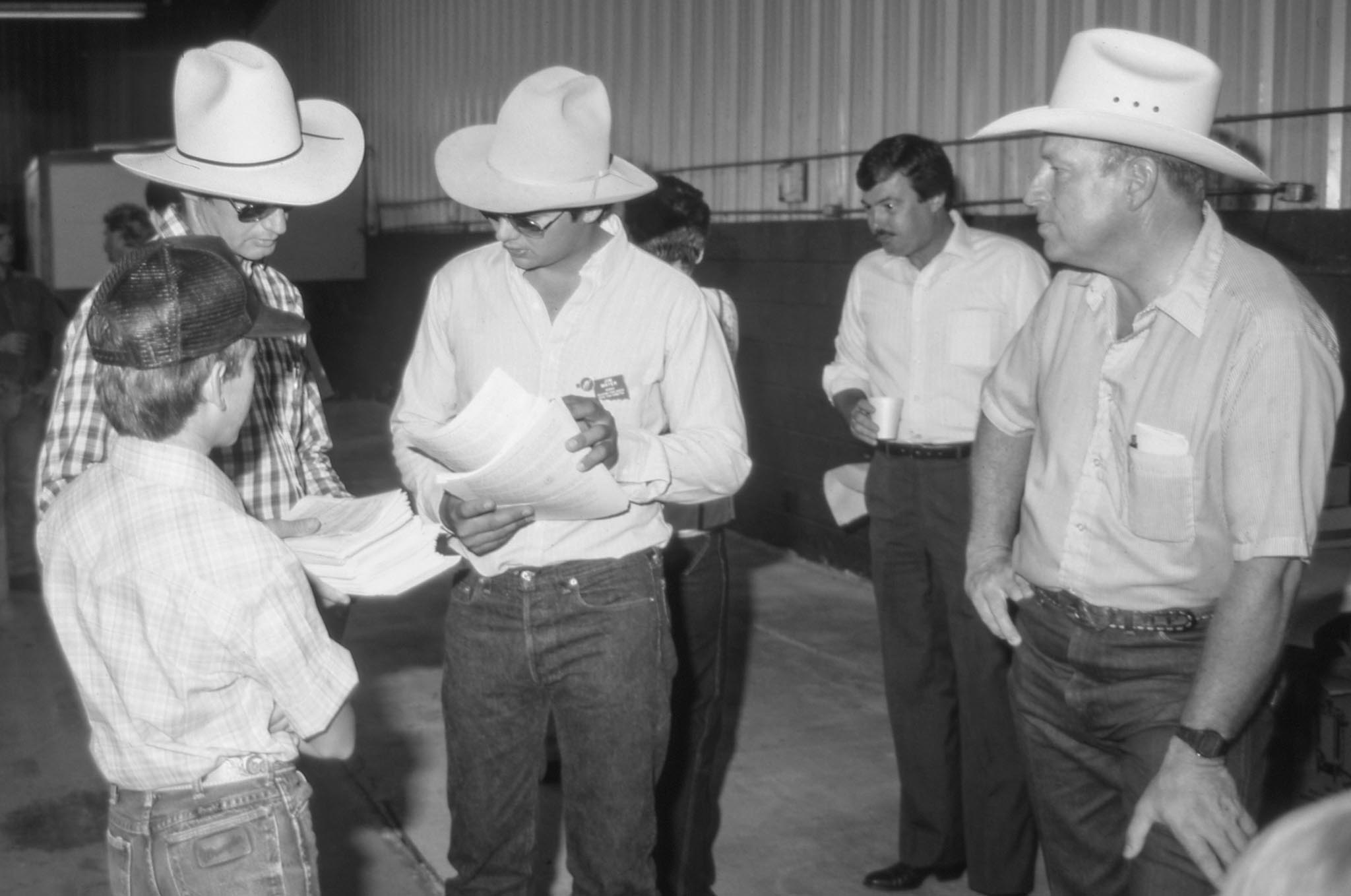 OKFB Young Farmers & Ranchers often sponsor agricultural activities and contests for youth. This photo was taken at the OKFB YF&R-sponsored Livestock Evaluation Field Day in 1986, where Texas County Farm Bureau member Jim Mayer, who also served as state YF&R chairman (center), assisted with the planning and organization of the contest.