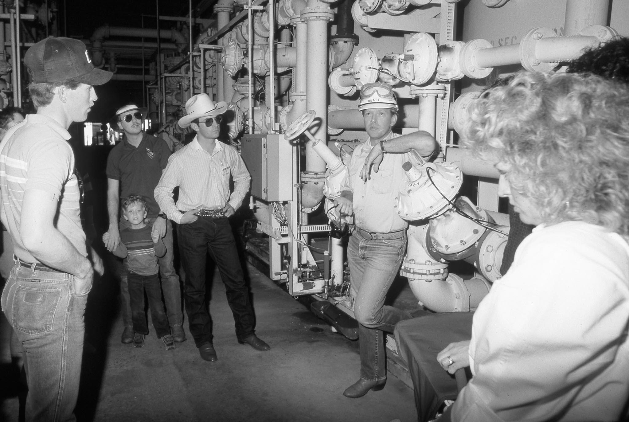 In this photo, OKFB Young Farmers & Ranchers members tour Farmland Industries for a firsthand look at the plant's manufacturing process for urea and nitrate fertilizers during the group's winter conference held in Enid in 1987.