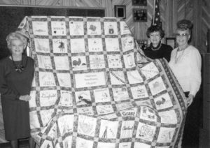 Oklahoma Farm Bureau celebrated their 50th anniversary in 1992 with several unique opportunities for the organization's members. In one such event, Glencoe's Wanita McGuar (right) was the lucky winner of the 50th anniversary OKFB commemorate quilt. The state's Women's Committee coordinated the effort to make the quilt, which involved women from all 77 counties. Women's Committee Chairman Nellie Fern Nelson (left) and member Juanita Bolay were on hand to present the quilt to the Noble County Farm Bureau member.