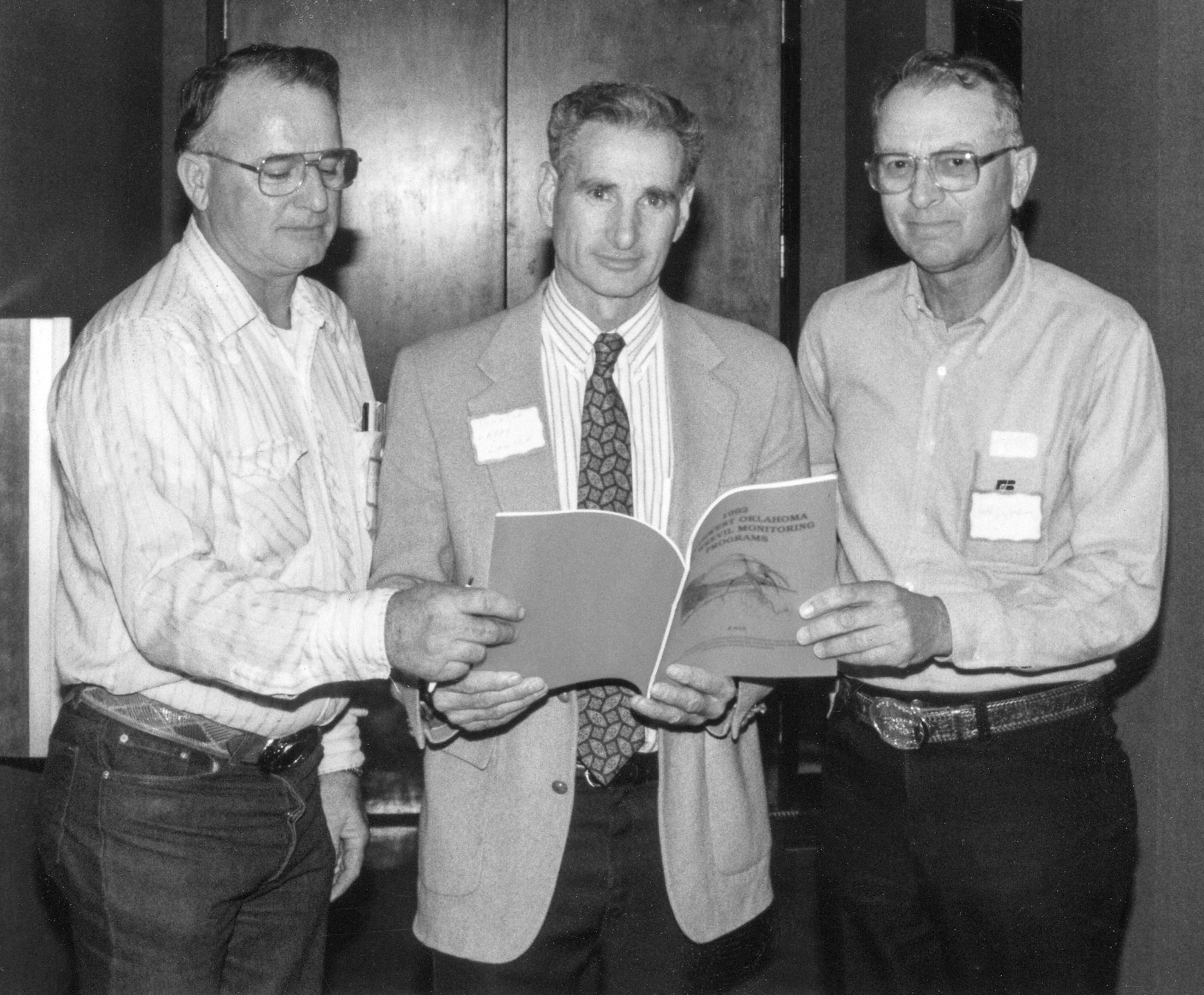 In 1993, boll weevil problems were a popular topic among farmers. In order to provide farmers and legislators with information concerning boll weevil eradication, Stephens County Farm Bureau held a meeting in late March at the Red River Vo-Tech. Pictured here is Oklahoma Sen. Larry Lawler, center, looking over boll weevil eradication facts with Stephens County President Bill Nunley (left) and Oklahoma Farm Bureau Board Member Ralph Dickson. Lawler was the Vice Chairman of the Senate Agriculture Committee.