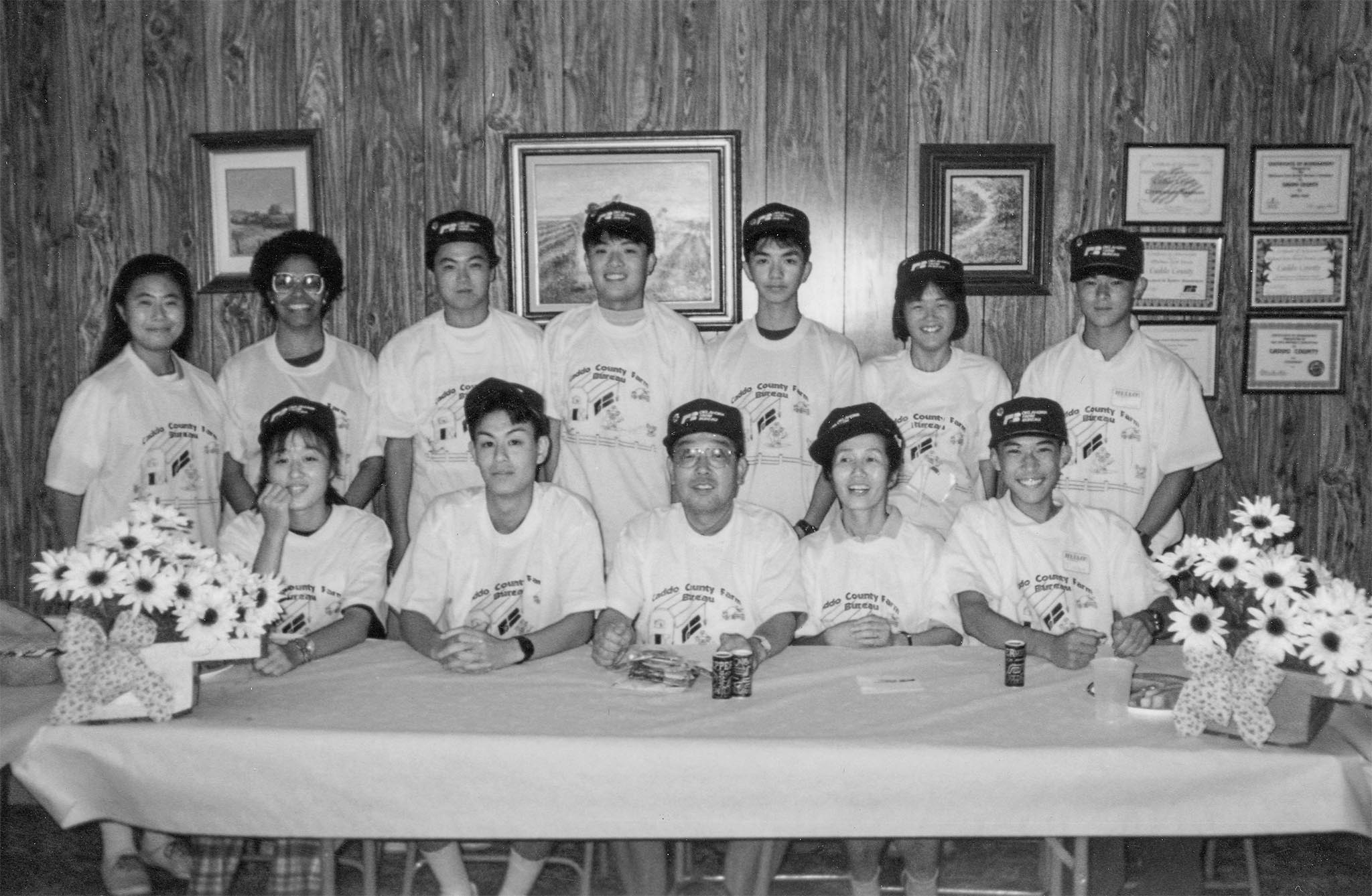 This 1994 photo includes program members from Japan after they enjoyed a home-prepared meal of Indian tacos and exchanged gifts during a stop at the Caddo County Farm Bureau office. The group was also presented with T-shirts and Farm Bureau caps as well as seedless watermelons provided by Sen. Bruce Price. The visiting group presented fans, handkerchiefs and buttons promoting Japan to the county Farm Bureau members.