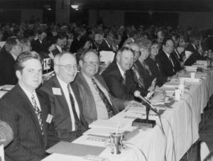 During the 1995 American Farm Bureau Federation annual meeting in St. Louis, Missouri, policy work in preparation for the upcoming farm bill took center stage. Delegates advocated for a more flexible approach to farm programs, as the delegate body passed a resolution opposing all tax increases and calling for a freeze in federal spending. Members of the 1995 Oklahoma delegation included (left to right) Oklahoma Farm Bureau Young Farmers & Ranchers Chairman Ryan Pjesky, OKFB President Eldon Merklin, Cotton County's Clarence Vache, OKFB Vice President Steve Kouplen, OKFB Board Member Billy Gibson, Farm Bureau Women's Committee Members Beverly Delmedico and Juanita Bolay, and OKFB Board Member Ron Henson.