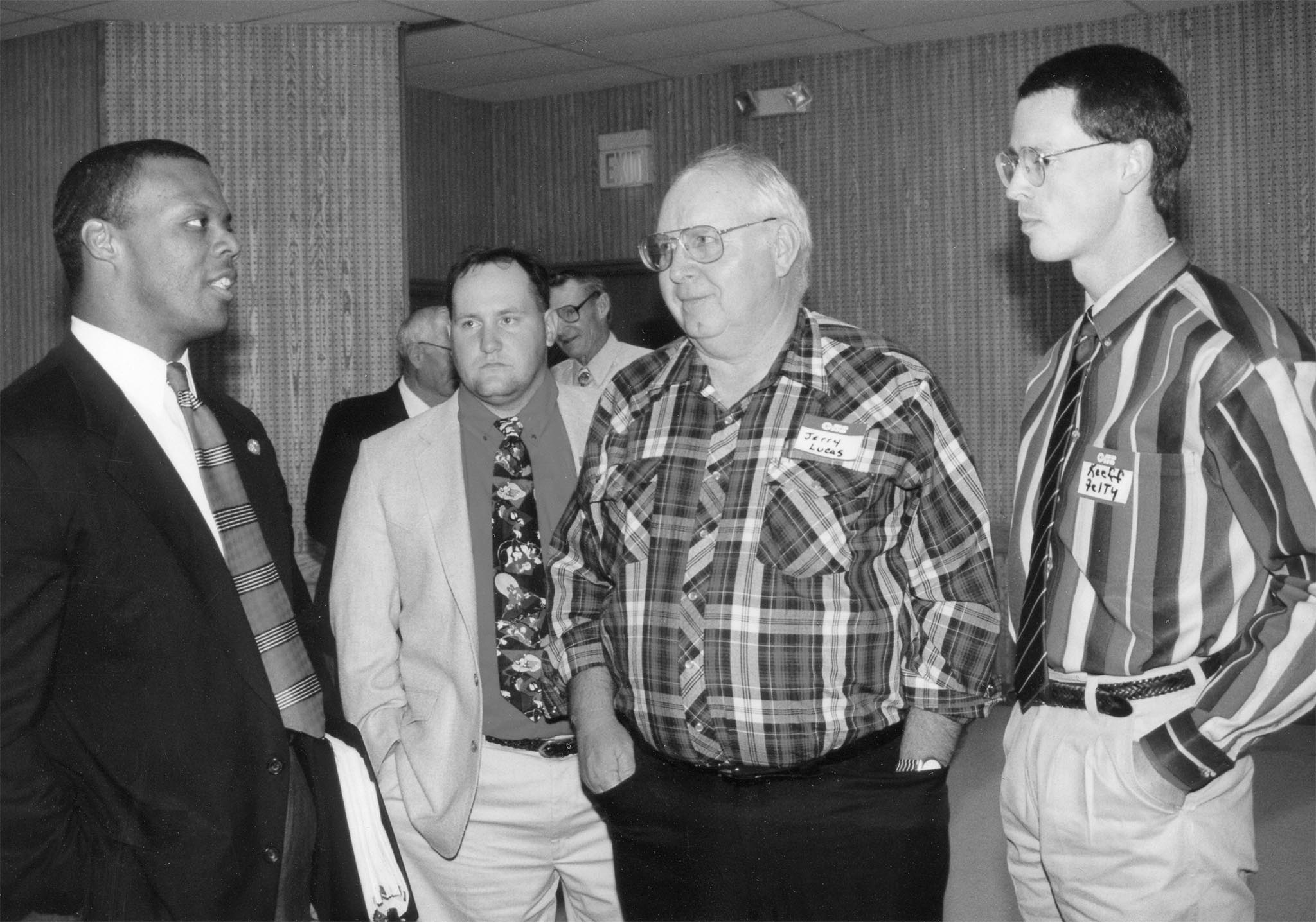 In this photo, U.S. Rep. J.C. Watts visits with Jackson County Farm Bureau members Greg Lucas and Jerry Lucas during the eight-county legislative banquet held in Lawton in 1996. Watts spoke to more than 100 Farm Bureau members, addressing family values, high taxes, the increasing national debt and other issues.