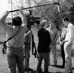 In this photo, CNN Newsman David Steck interviews OKFB Young Farmers & Ranchers members Tom Null, Keeff Felty and Matt Muller about weather forecasting's impact on farming. The CNN crew was in Oklahoma on April 21, 1998, to videotape a story on severe weather awareness, and quizzed the YF&R members about any folklore-type indicators farmers recognized as precursors of storms.
