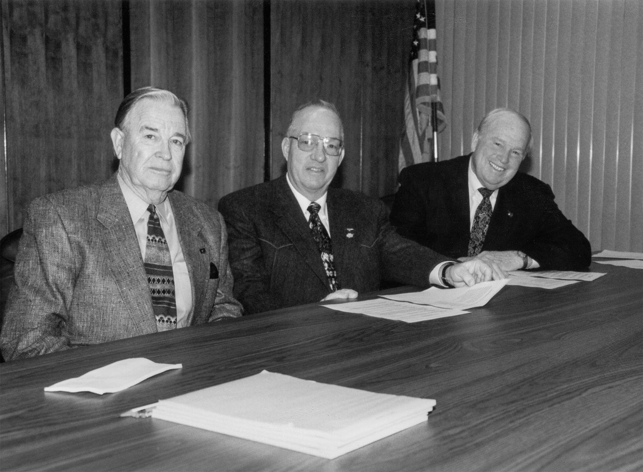 In 1998, presidents of the Oklahoma Farmers Union, Oklahoma Farm Bureau and the Oklahoma Cattlemen's Association joined leaders of other state organizations to create the Oklahoma Agriculture Roundtable. The group united forces on several agriculture industry issues on the table for the 1998 legislative session, such as the wheat checkoff, estate taxes, livestock liability and more. This photo was taken as OKFB President Jack M. Givens (left), OCA President Stanley Barby (center), and OFU President Phil Klutts prepared to open the Oklahoma Agriculture Roundtable.