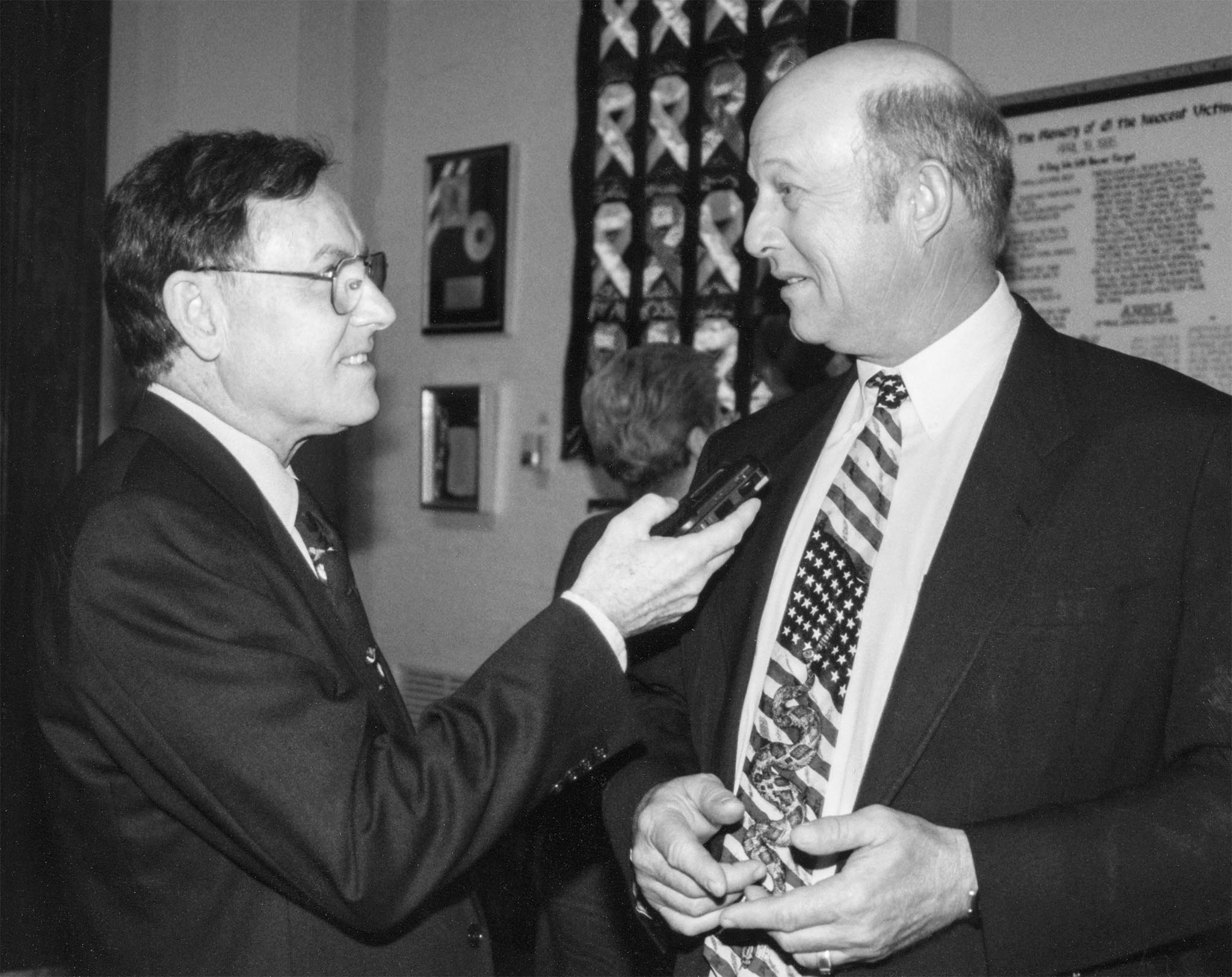 Drought was a significant concern among farmers and ranchers in the Oklahoma Panhandle in the late 1990s. Relaying the challenges the dry conditions brought, Oklahoma Farm Bureau Board Member Joe Mayer (right) spoke to the Daily Oklahoman's Paul English at a Governor's Press Conference in 1998. Mayer outlined current and future problems caused by the drought and how those issues would impact Oklahoma farmers and ranchers.