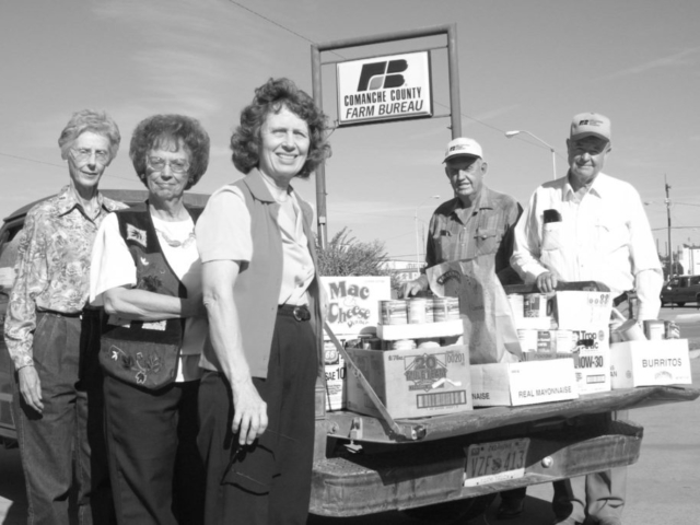 Community services is an integral part of county Farm Bureau activities in communities throughout Oklahoma. Here, Comanche County Farm Bureau members display a bounty of collected food items to donate to their local food pantry in 2003, part of an annual drive that continues today. Pictured are (left to right) Comanche County's Beverly Glasgow, Rhonda Hankins, Georgia Doye, Damon Doye and Don Hankins.
