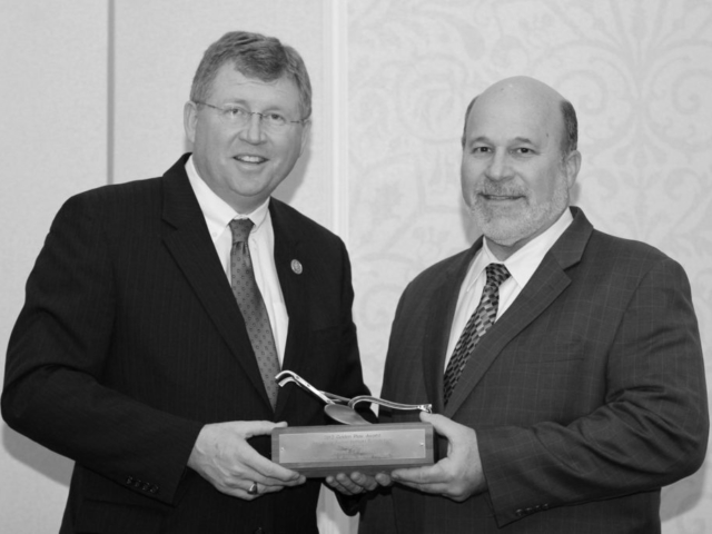 A longtime Oklahoma Farm Bureau member, U.S. Rep. Frank Lucas of Roger Mills County (left) received the 2012 American Farm Bureau Federation's Golden Plow award from AFBF President Bob Stallman at the 2013 OKFB Legislative Leadership Conference. Lucas was recognized for his work on researching and developing the next farm bill. The Golden Plow is the highest honor AFBF bestows upon congressional leaders, recognizing members of Congress who exemplify agricultural leadership and support of Farm Bureau policies. Recipients are chosen for having a philosophy or record that demonstrates a commitment to sound agricultural policies supported by Farm Bureau, the private enterprise system, fiscal conservatism and reduced federal regulation of businesses and individuals.