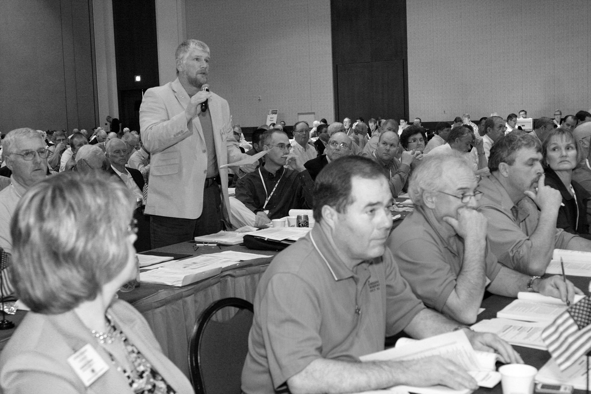 With a 2012 deadline for a new farm bill looming on the horizon, Oklahoma Farm Bureau members created a farm bill committee to study the current farm program, consult agricultural experts, and present policy proposals to the delegate body to help craft the next iteration of farm policy. This input was taken and approved ideas were sent on for consideration by American Farm Bureau Federation delegates. Here, Scott Neufeld of Major County, a member of the OKFB Farm Bill Committee, speaks at the business session of the 2012 AFBF convention in Honolulu, Hawaii, about a proposed AFBF policy change to the national organization's farm bill policy.