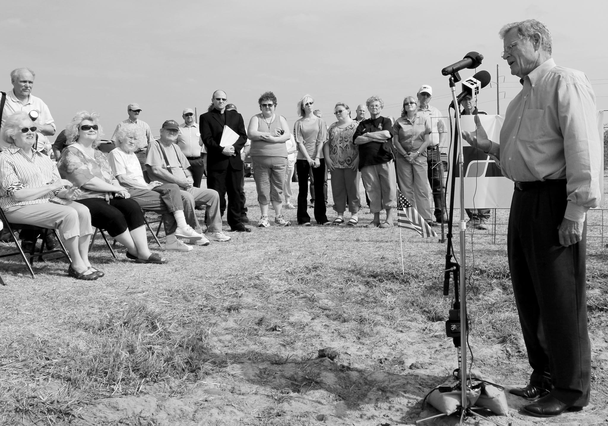 U.S. Sen. Jim Inhofe, standing in an old buffalo wallow, speaks against government overreach in proposed changes to the Clean Water Act during a 2012 press conference hosted by Oklahoma Farm Bureau. The press event was held on land owned by Garfield County Farm Bureau member Gary Johnson.q