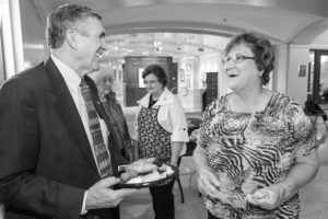 Here, Sen. Ron Justice of Chickasha (left) visits with Caddo County Farm Bureau's Linda Taggart at the state capitol during the 2013 Farm City Festival held April 23.