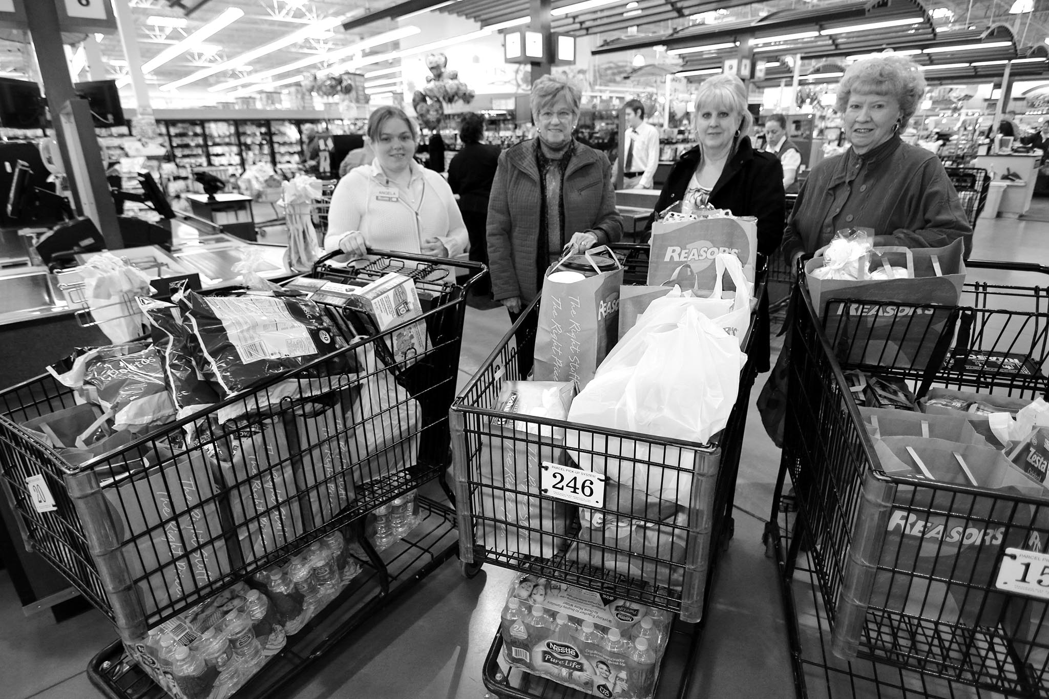 Connecting consumers with food and agriculture information is the goal of the long-running food donation efforts the Oklahoma Farm Bureau Women's Leadership Committee has undertaken through Food Check-Out Day, and later, Our Food Link activities. As part of the program, OKFB WLC members purchase food and gift certificates to donate to the Ronald McDonald House Charities in Oklahoma City and Tulsa, providing families who have a child receiving treatment at nearby hospitals with a myriad of food choices during their stay. In this 2014 Our Food Link photo, OKFB WLC members Beverly Delmedico (right) and Lena Henson (second from left) shop for food to donate at a Tulsa-area Reasor's store with OKFB WLC Coordinator Marcia Irvin (second from right). Also pictured is a member of the Reasor's staff who helped the WLC members.