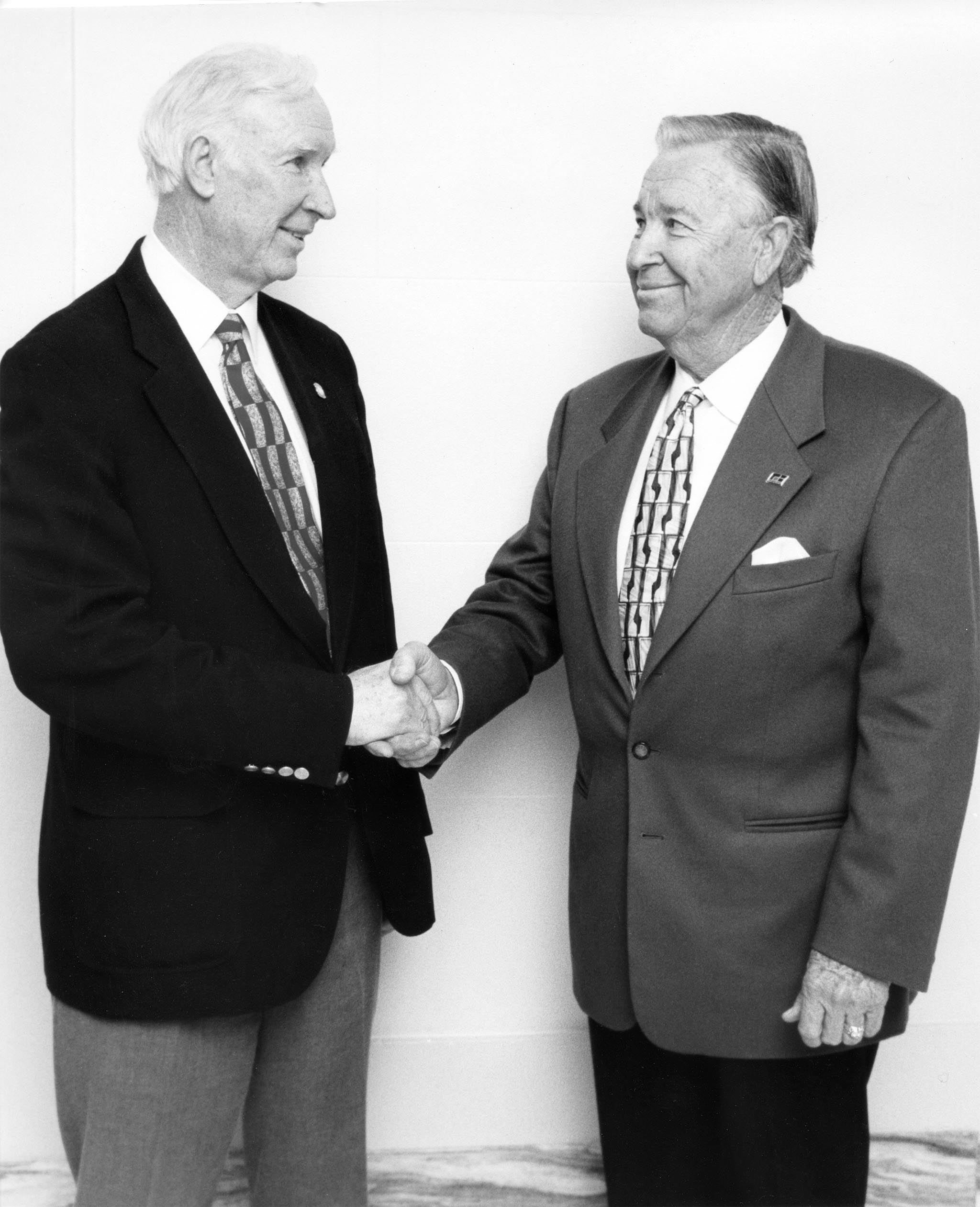 Oklahoma Farm Bureau Vice President Jack Givens, right, offers congratulations to Sen. Gilmer Capps upon the Snyder legislator being named winner of the Oklahoma Association of Conservation Districts' Hall of Fame Award in 1997.